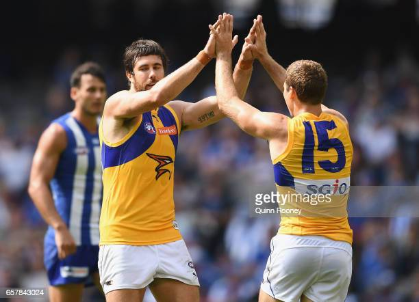 Josh Kennedy of the Eagles is congratulated by Jamie Cripps after kicking a goal during the round one AFL match between the North Melbourne Kangaroos...