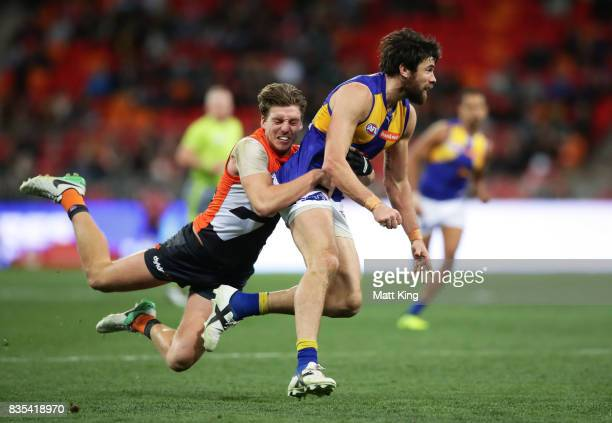 Josh Kennedy of the Eagles is tackled by Aidan Corr of the Giants during the round 22 AFL match between the Greater Western Sydney Giants and the...