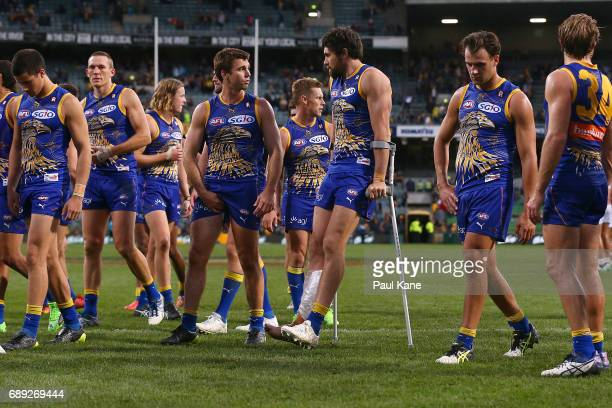 Josh Kennedy of the Eagles leaves the field on crutches after being defeated during the round 10 AFL match between the West Coast Eagles and the...