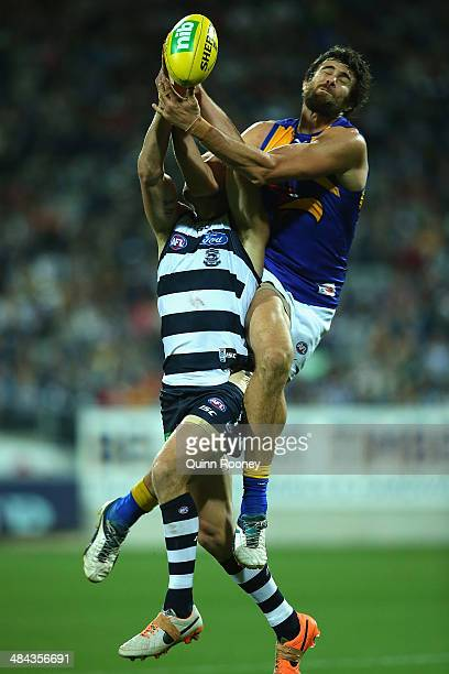 Josh Kennedy of the Eagles marks over the top of James Kelly of the Cats during the round four AFL match between the Geelong Cats and the West Coast...