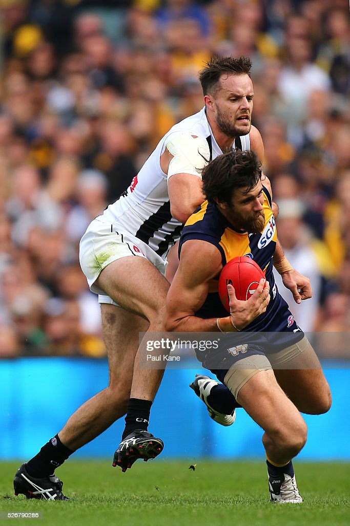 Josh Kennedy of the Eagles marks the ball against <a gi-track='captionPersonalityLinkClicked' href=/galleries/search?phrase=Nathan+Brown+-+Australian+Rules+Football+Player+-+Born+1988&family=editorial&specificpeople=15039192 ng-click='$event.stopPropagation()'>Nathan Brown</a> of the Magpies during the round six AFL match between the West Coast Eagles and the Collingwood Magpies at Domain Stadium on May 1, 2016 in Perth, Australia.