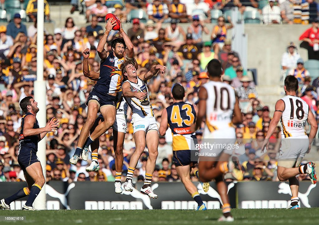 Josh Kennedy of the Eagles marks the ball against Ryan Schoenmakers of the Hawks during the round two AFL match between the West Coast Eagles and the Hawthorn Hawks at Patersons Stadium on April 7, 2013 in Perth, Australia.