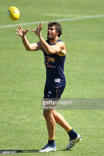 Josh Kennedy of the Eagles marks the ball during a West Coast Eagles AFL training session at Patersons Stadium on February 13 2014 in Perth Australia