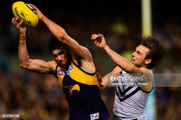 Josh Kennedy of the Eagles takes a mark in front of Joel Hamling of the Dockers during the 2017 AFL round 06 match between the West Coast Eagles and...