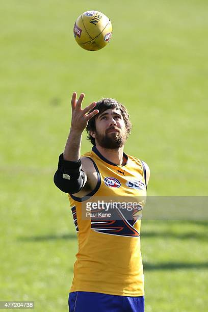 Josh Kennedy of the Eagles throws the ball into the air during a West Coast Eagles AFL training session at Domain Stadium on June 15 2015 in Perth...