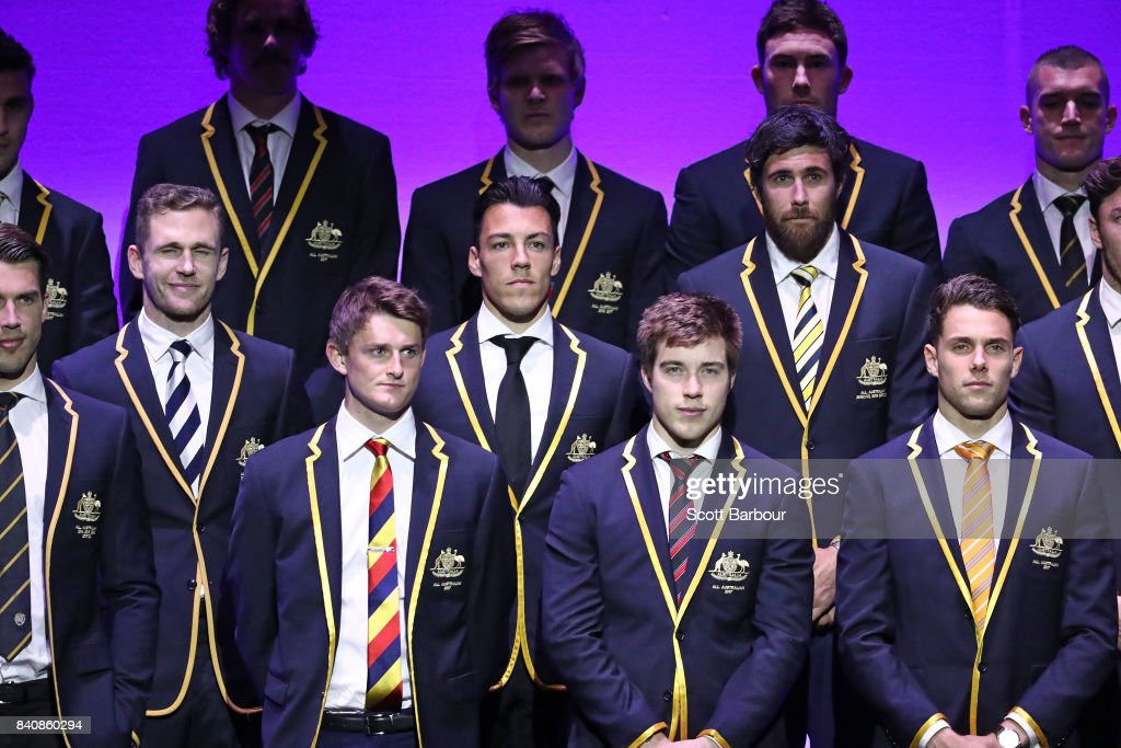 Josh Kennedy of the Eagles, Zach Merrett of the Bombers, Joel Selwood of the Cats, Dylan Shiel of the Giants and the AFL All Australian team pose on stage during the AFL All Australian team announcement at the Palais Theatre on August 30, 2017 in Melbourne, Australia.