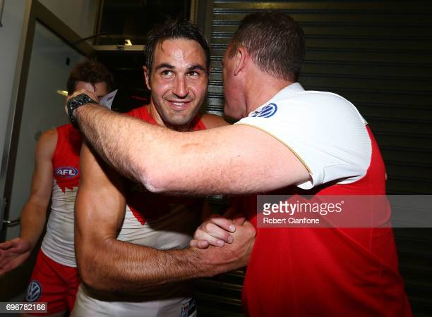 Josh Kennedy of the Swans and Swans coach John Longmire celebrate after the Swans defeated the Tigers during the round 13 AFL match between the...