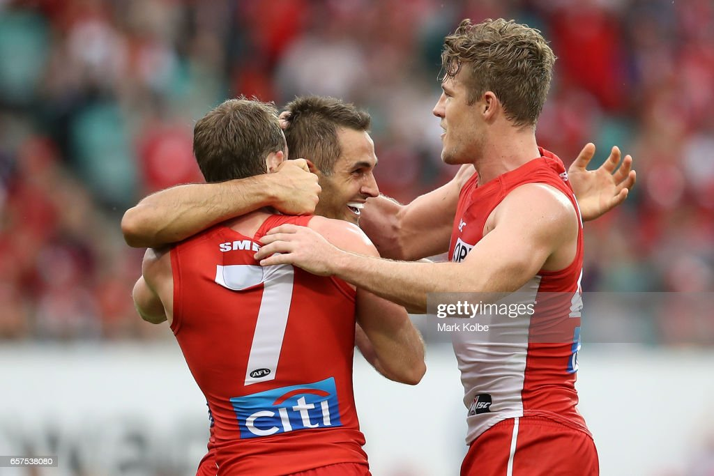 Josh Kennedy of the Swans celebrates with his team mates after kicking a goal during the round one AFL match between the Sydney Swans and the Port Adelaide Power at Sydney Cricket Ground on March 25, 2017 in Sydney, Australia.