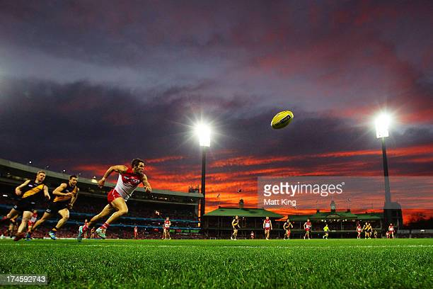 Josh Kennedy of the Swans chases the ball during the round 18 AFL match between the Sydney Swans and the Richmond Tigers at SCG on July 28 2013 in...