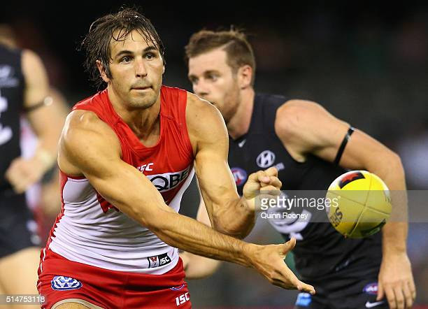 Josh Kennedy of the Swans handballs during the NAB Challenge AFL match between the Carlton Blues and the Sydney Swans at Etihad Stadium on March 11...