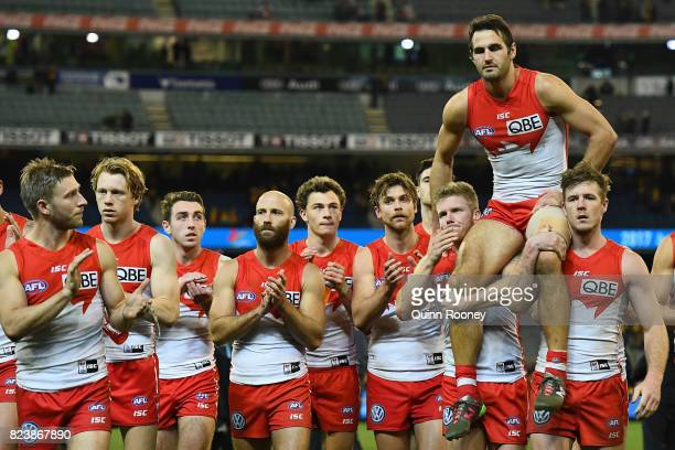 Josh Kennedy of the Swans is chaired off in his 200th game during the round 19 AFL match between the Hawthorn Hawks and the Sydney Swans at Melbourne...