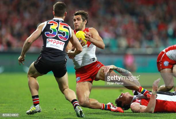 Josh Kennedy of the Swans is tackled during the round 18 AFL match between the Sydney Swans and the St Kilda Saints at Sydney Cricket Ground on July...