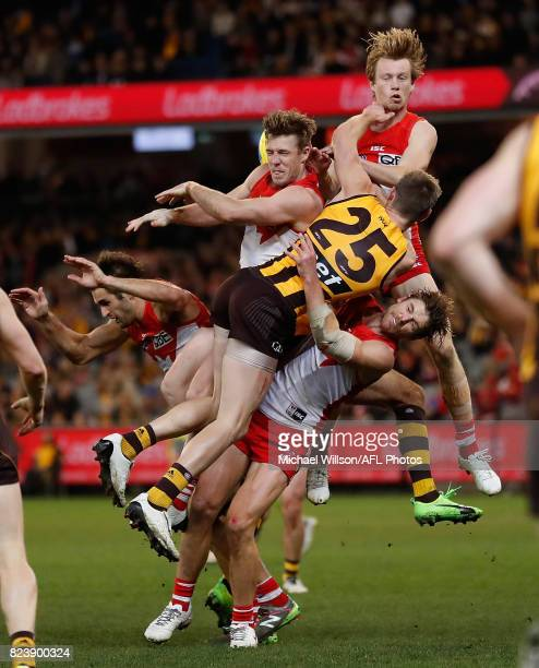Josh Kennedy of the Swans Luke Parker of the Swans Ryan Schoenmakers of the Hawks Callum Mills of the Swans and Dane Rampe of the Swans compete for...