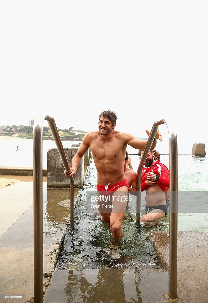 Josh Kennedy of the Swans swims during a recovery session at Coogee Beach on September 15, 2013 in Sydney, Australia.