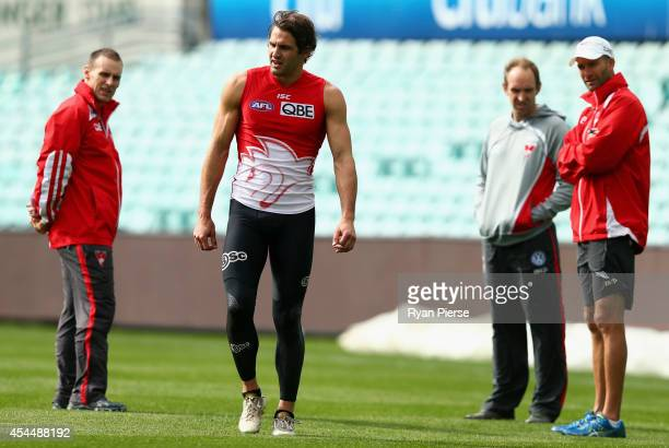 Josh Kennedy of the Swans walks away from medical staff during a fitness test during a Sydney Swans AFL training session at Sydney Cricket Ground on...