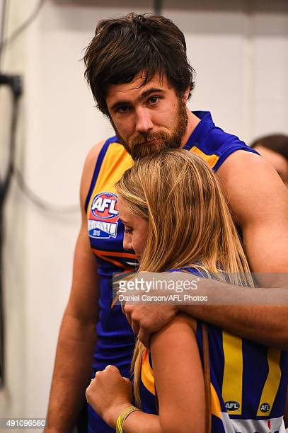 Josh Kennedy of the West Coast Eagles is comforted in the rooms during the 2015 Toyota AFL Grand Final match between the Hawthorn Hawks and the West...
