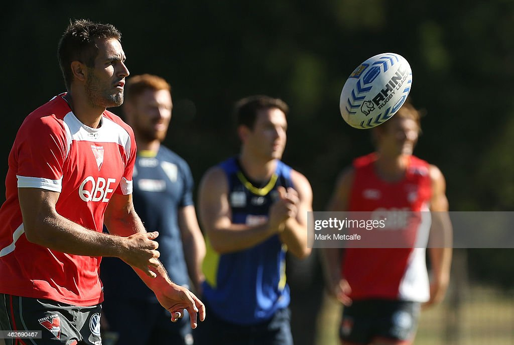 Josh Kennedy passes a rugby league ball during a Sydney Swans AFL pre-season training session at Lakeside Oval on January 15, 2014 in Sydney, Australia.