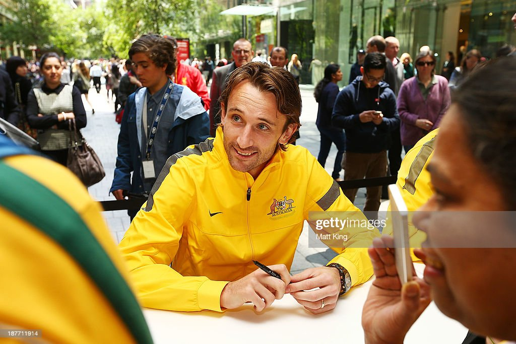 Josh Kennedy signs autographs for fans during an Australian Socceroos public appearance at Westfield Sydney on November 12, 2013 in Sydney, Australia.