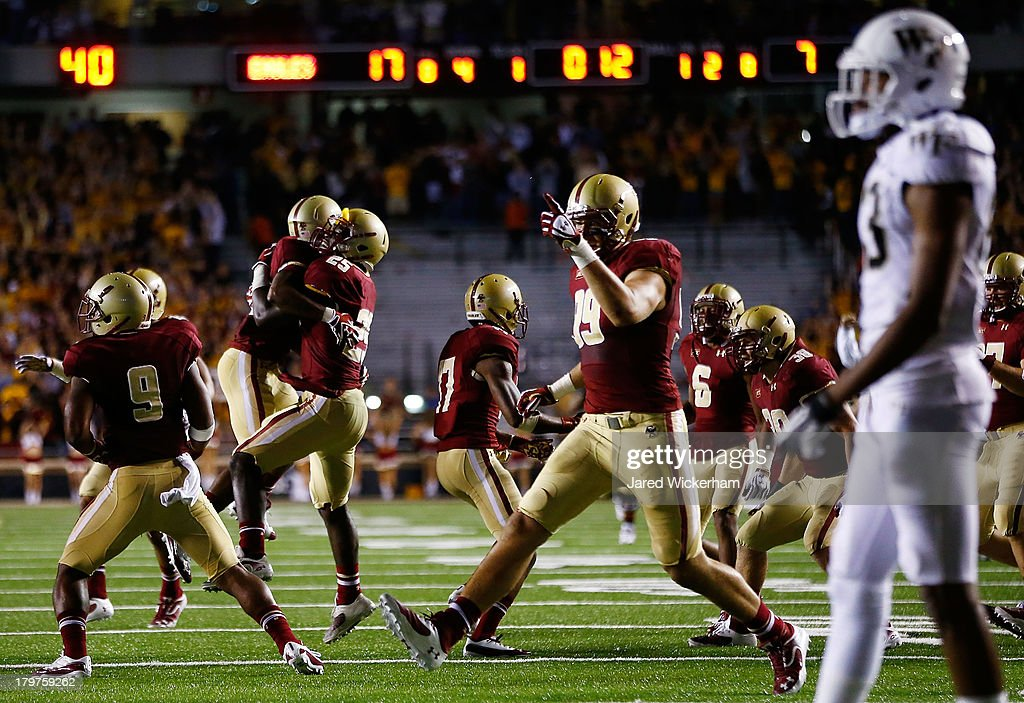 Josh Keyes #25 and Brian Mihalik #99 of the Boston College Eagles celebrate following a fourth and one stop near the goal line against the Wake Forest Demon Deacons during the game on September 6, 2013 at Alumni Stadium in Chestnut Hill, Massachusetts.