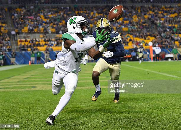 Josh Knight of the Marshall Thundering Herd catches a touchdown pass in front of Terrish Webb of the Pittsburgh Panthers during the third quarter at...