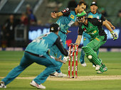 Josh Lalor of the Heat saves an overthrow as Evan Gulbis of the Stars survives a runout during the Big Bash League match between the Melbourne Stars...