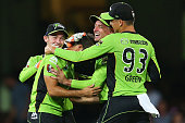 Josh Lalor of the Thunder celebrates with team mates after claiming the wicket of Michael Lumb of the Sixers during the Big Bash League match between...