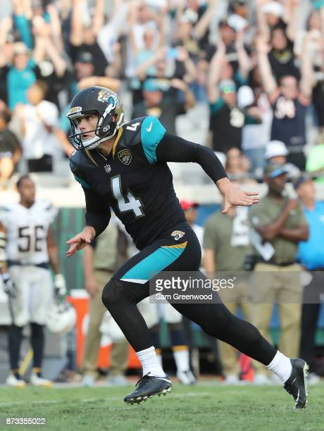 Josh Lambo of the Jacksonville Jaguars celebrates after he made a 30yard field goal in overtime as the Jacksonville Jaguars defeated the Los Angeles...