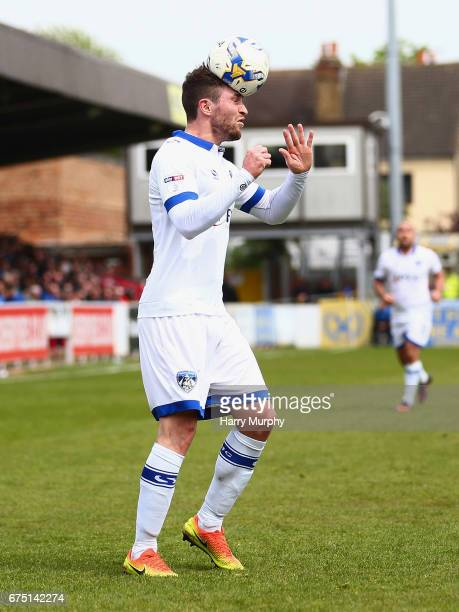 Josh Law of Oldham Athletic heads the ball during the Sky Bet League One match between AFC Wimbledon and Oldham Athletic at The Cherry Red Records...