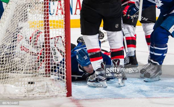 Josh Leivo of the Toronto Maple Leafs lays on the ice after scoring against the New Jersey Devils during the first period at the Air Canada Centre on...