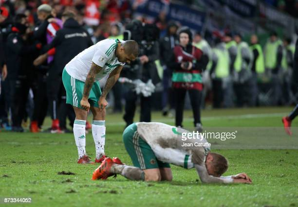 Josh Magennis and George Saville of Northern Ireland following the FIFA 2018 World Cup Qualifier PlayOff Second Leg between Switzerland and Northern...