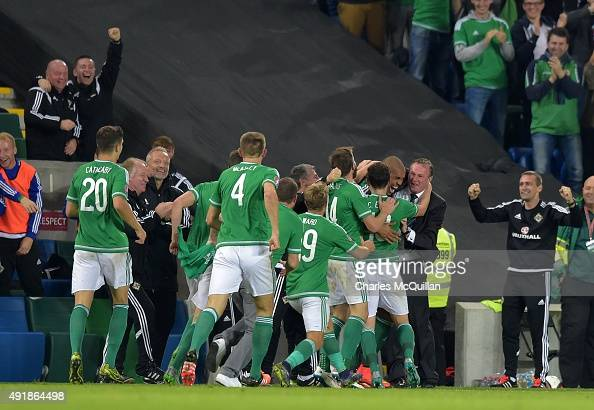 Josh Magennis of Northern Ireland celebrates with manager Michael O'Neill after scoring their second goal during the UEFA EURO 2016 qualifier between...