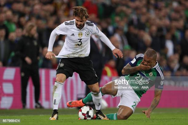 Josh Magennis of Northern Ireland competes with Marvin Plattenhardt of Germany during the FIFA 2018 World Cup Qualifier between Northern Ireland and...