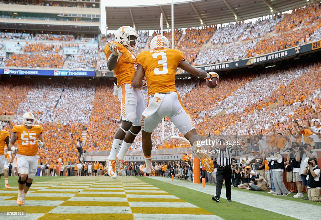 Josh Malone of the Tennessee Volunteers celebrates with Pig Howard after Malone caught a touchdown pass against the Oklahoma Sooners during the game...