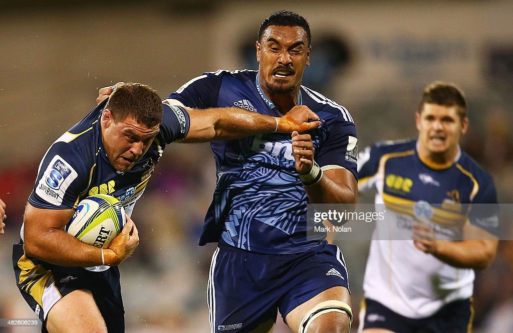 Josh Mann-Rae of the Brumbies is tackled by Angus Ta'Avao of the Blues during the round eight Super Rugby match between the Brumbies and the Bulls at Canberra Stadium on April 4, 2014 in Canberra, Australia.