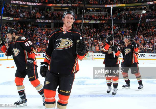 Josh Manson Jared Boll Cam Fowler and Nick Ritchie of the Anaheim Ducks wave to the crowd following their 21 win over the Edmonton Oilers in Game...