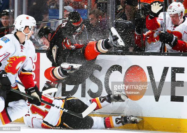 Josh Manson of the Anaheim Ducks battles against Matthew Tkachuk of the Calgary Flames in Game One of the Western Conference First Round during the...