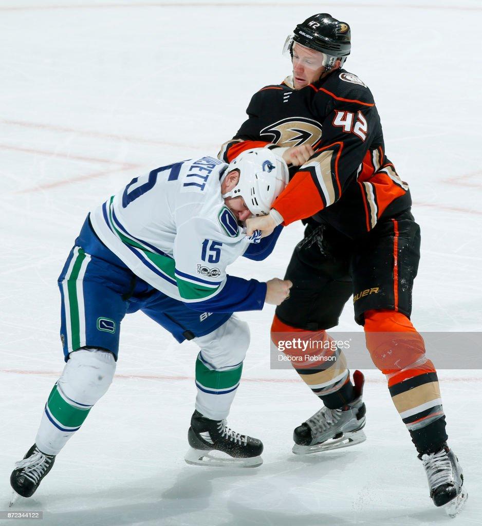 Josh Manson #42 of the Anaheim Ducks battles in a fight against Derek Dorsett #15 of the Vancouver Canucks during the game on November 9, 2017 at Honda Center in Anaheim, California.