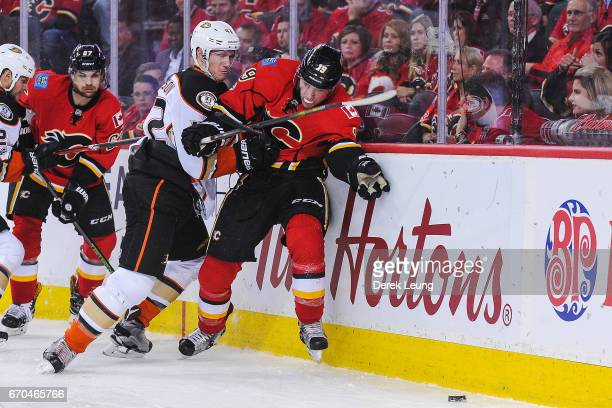 Josh Manson of the Anaheim Ducks checks Matthew Tkachuk of the Calgary Flames in Game Four of the Western Conference First Round during the 2017 NHL...