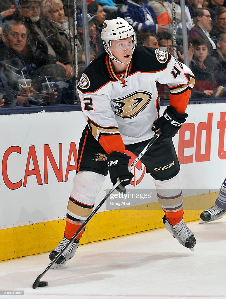 <a gi-track='captionPersonalityLinkClicked' href=/galleries/search?phrase=Josh+Manson&family=editorial&specificpeople=10214669 ng-click='$event.stopPropagation()'>Josh Manson</a> #42 of the Anaheim Ducks controls the puck against the Toronto Maple Leafs during game action on March 24, 2016 at Air Canada Centre in Toronto, Ontario, Canada.