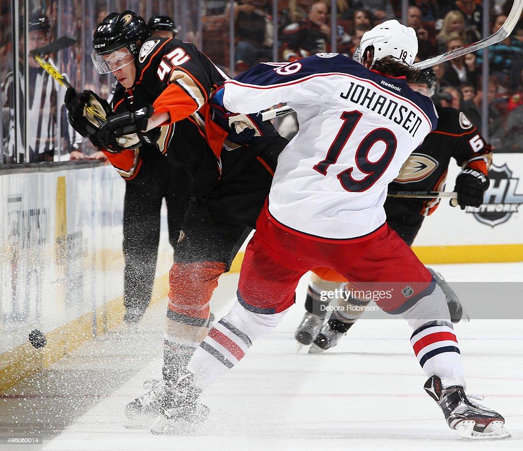 Josh Manson #42 of the Anaheim Ducks gets hit by Ryan Johansen #19 of the Columbus Blue Jackets on November 6, 2015 at Honda Center in Anaheim, California.