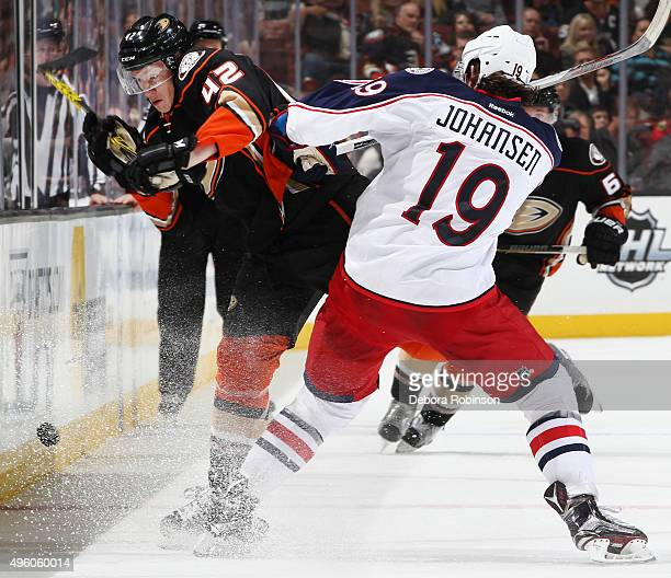 Josh Manson of the Anaheim Ducks gets hit by Ryan Johansen of the Columbus Blue Jackets on November 6 2015 at Honda Center in Anaheim California