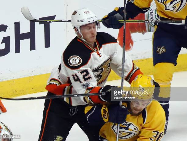 Josh Manson of the Anaheim Ducks hits Viktor Arvidsson of the Nashville Predators in Game Three of the Western Conference Final during the 2017 NHL...