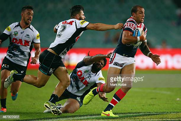 Josh Mansour and Jamal Idris of the Panthers are beaten by Blake Ferguson of the Roosters during the round three NRL match between the Sydney...