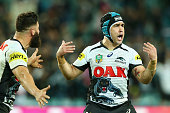 Josh Mansour and Jamie Soward of the Panthers celebrate after Soward kicked a field goal for victory during the NRL 1st Qualifying Final match...