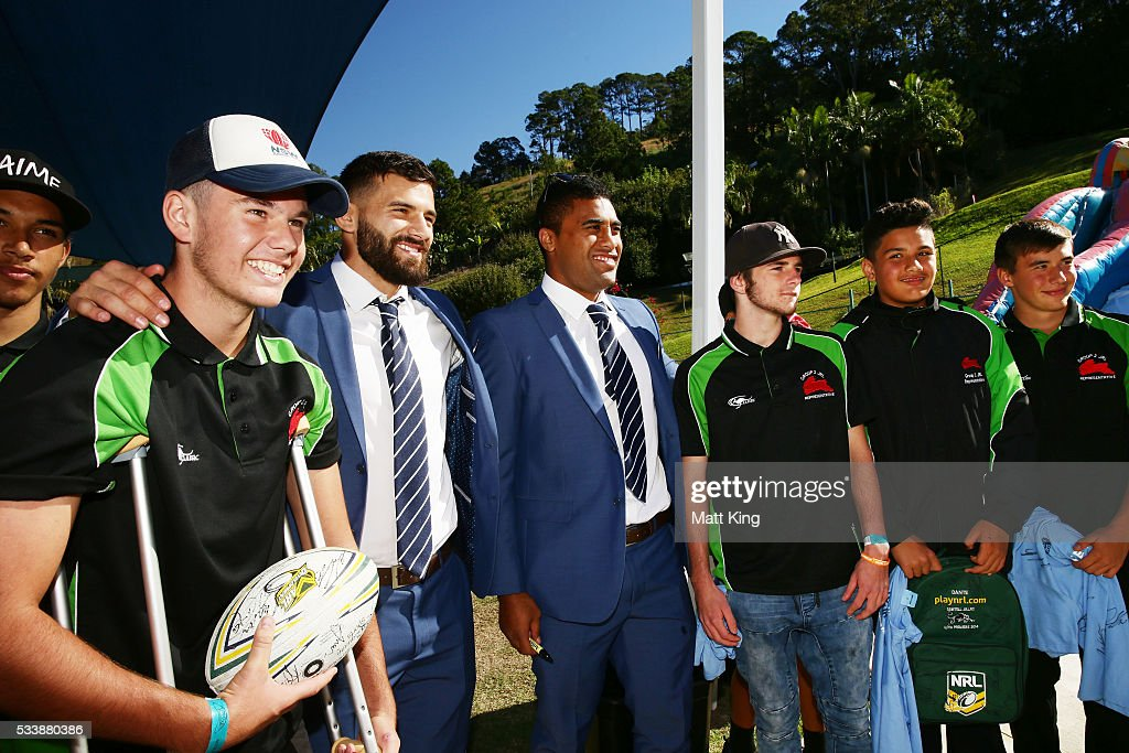 Josh Mansour (L) and Michael Jennings (R) of the Blues pose with young rugby league players during a New South Wales Blues NRL State of Origin Welcome Session at The Big Banana on May 24, 2016 in Coffs Harbour, Australia.