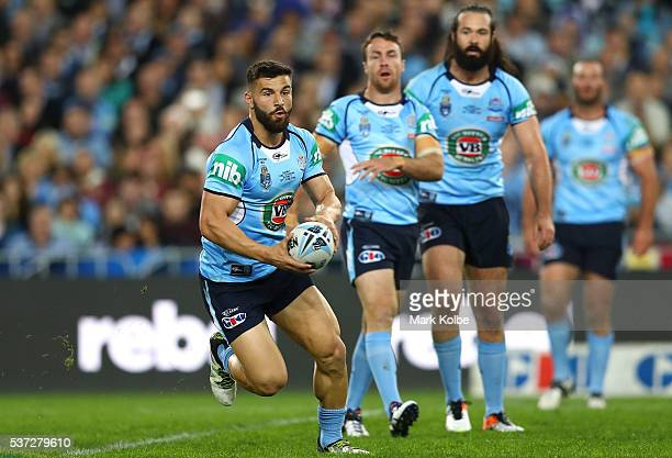 Josh Mansour of the Blues runs the ball during game one of the State Of Origin series between the New South Wales Blues and the Queensland Maroons at...