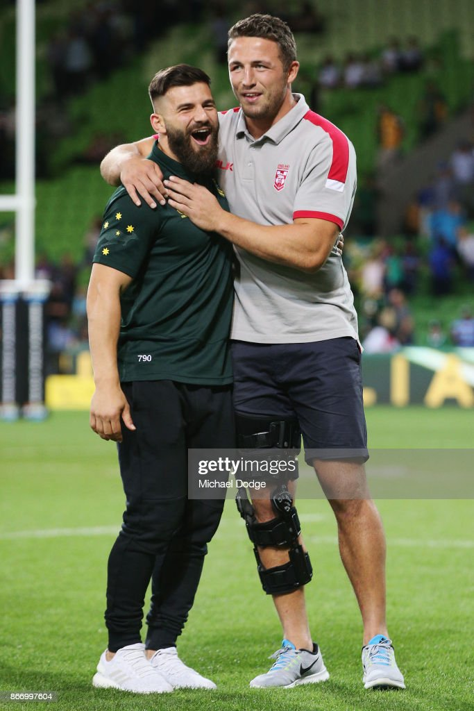 Josh Mansour of the Kangaroos (L) consoles the defeated and injured Sam Burgess of England during the 2017 Rugby League World Cup match between the Australian Kangaroos and England at AAMI Park on October 27, 2017 in Melbourne, Australia.