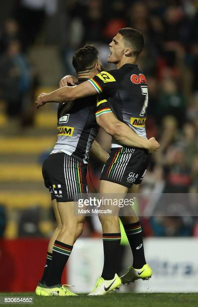 Josh Mansour of the Panthers celebrates scoring a try with team mate Nathan Cleary of the Panthers during the round 23 NRL match between the Penrith...