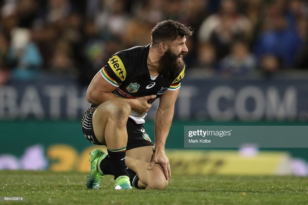 Josh Mansour of the Panthers grimaces after a tackle during the round 14 NRL match between the Penrith Panthers and the Canberra Raiders at Carrington Park on June 10, 2017 in Bathurst, Australia.