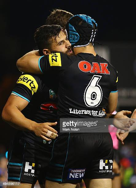 Josh Mansour of the Panthers is congratulated after scoring during the round 12 NRL match between the Penrith Panthers and the Parramatta Eels at...